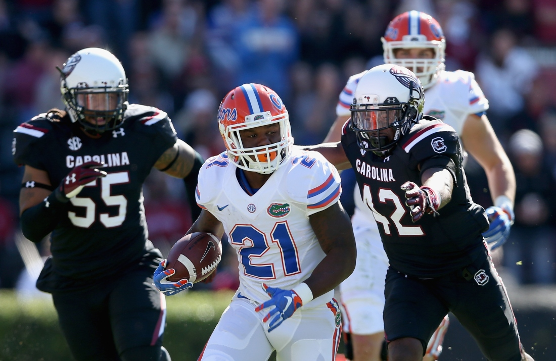 Kelvin Taylor breaking through, and breaking out backs. (Photo: palmbeachpost.com)